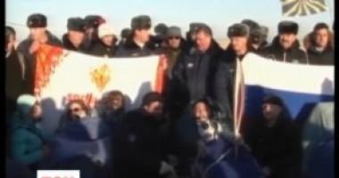 Союз вернулся на Землю с космонавтами и олимпийским факелом