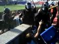 Опубликовано новое видео избиения росийским ОМОНом безногого инвалида на трибуне
