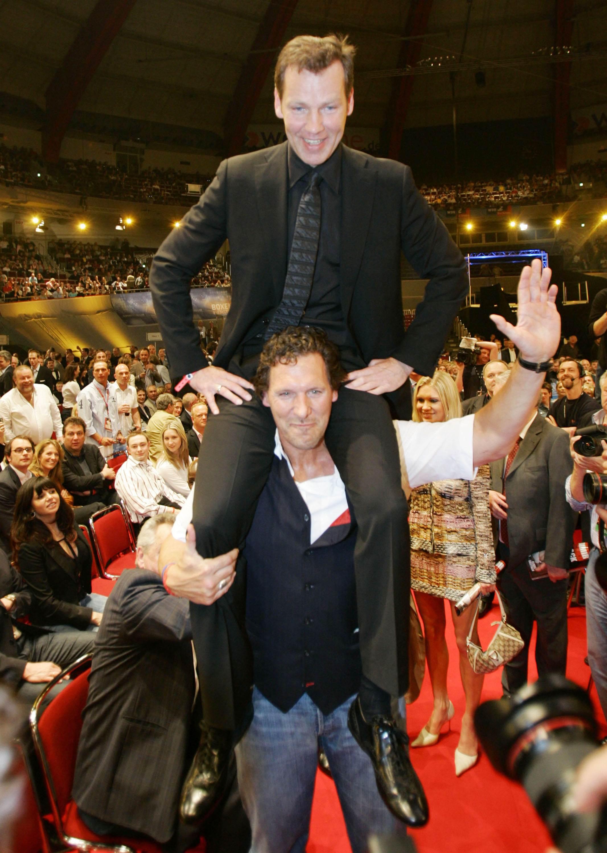Немецкий актер и бывший культурист Ральф Меллер и олимпийский чемпион по боксу Генри Маске