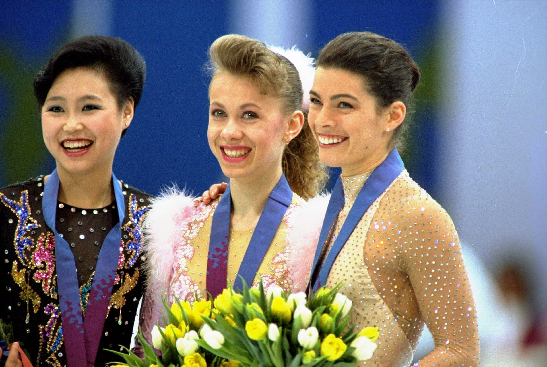 Олимпийская чемпионка Оксана Баюл (в центре) и призеры Игр в Лиллехамере - китаянка Лю Чен (слева) и американка Нэнси Керриган (справа)