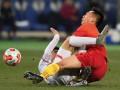 Китайскому футболисту откусили часть уха во время матча
