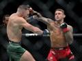 Макгрегор сломал ногу и уступил Порье в фантастическом бою на UFC 264