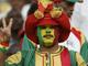 Победа - она и в Африке победа. Сенегальский болельщик демонстрирует всем известный жест