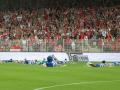 Покатушки на животах: футболисты прокатились по мокрому газону